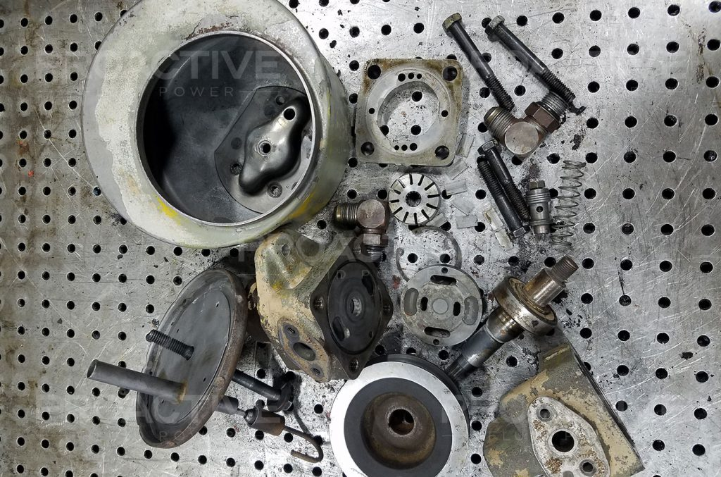 Vickers VT16 Power steering pump parts evaluated during a repair procedure.
